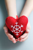 Christmas heart. Red Christmas heart in child hand Stock Photography