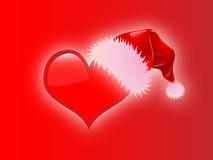 Christmas heart with santa hat red background Royalty Free Stock Photos