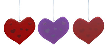 Christmas heart shape decorations hanging on white Stock Photography