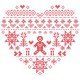 Christmas heart shape with gingerbread man on white background Royalty Free Stock Photos