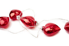 Christmas heart shaped red bauble lights isolated on white backg Stock Photography