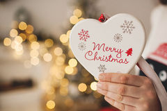 Christmas heart shaped toy in woman hands Royalty Free Stock Photo