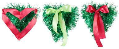 Christmas hearts. Christmas. Green and red hearts with bow. Isolated Stock Photography