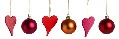 Christmas hearts and baubles Royalty Free Stock Images
