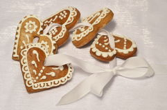 Christmas hearts. The christmas decoration gingerbread  on white ribbon Royalty Free Stock Image