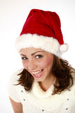 Christmas Is Here. Beautiful Woman Smiling And Wearing A Santa Hat Royalty Free Stock Photos