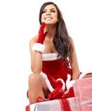 Christmas hispanic woman with gift Royalty Free Stock Photography