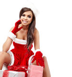 Christmas hispanic woman with gift Royalty Free Stock Photography