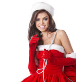 Christmas hispanic woman wearing a santa hat. Smiling Stock Photos