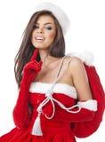 Christmas hispanic woman wearing a santa hat. Smiling Stock Image