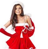 Christmas hispanic woman wearing a santa hat. Smiling Royalty Free Stock Photography