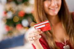 Christmas: Holding a Credit Card Royalty Free Stock Images