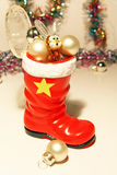 Christmas holiday. Red boot with gifts and hare Royalty Free Stock Images