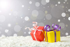 Christmas holiday. Christmas gift boxes on snow against defocused lights background Royalty Free Stock Image
