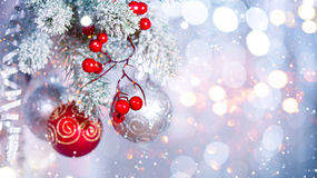 Christmas holiday abstract silver background. Hanging baubles on Christmas tree royalty free stock image