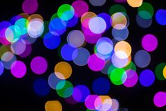 Christmas, holiday background. Abstract color bokeh in the night royalty free stock images