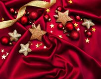 Christmas holiday background. Baubles on a red silk Royalty Free Stock Photos