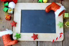 Christmas holiday background with blank chalkboard border for copy space and Christmas decorations. Royalty Free Stock Photo