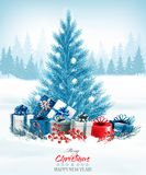 Christmas holiday background with a blue tree and presents. Royalty Free Stock Photography