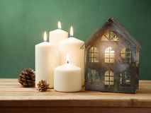 Christmas holiday background with candles and house decoration Stock Photo