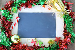 Christmas holiday background with chalk board. Christmas holiday background with chalkboard royalty free stock images
