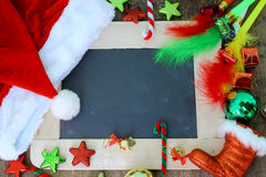 Christmas holiday background with chalkboard and decoration. Christmas holiday background with chalk board and decoration stock photo
