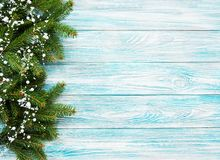 Christmas holiday background. Christmas tree and garland on a old wooden background royalty free stock image