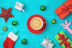 Christmas holiday background with coffee cup, gift boxes and dec royalty free stock images