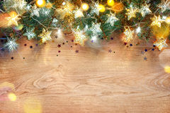 Christmas holiday background. Decorated fir tree with lights on wooden board Royalty Free Stock Photography