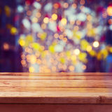 Christmas holiday background with empty wooden deck table over beautiful bokeh Royalty Free Stock Photography