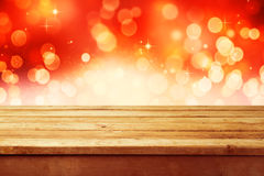Christmas holiday background with empty wooden deck table over festive bokeh. Ready for product montage. Christmas holiday shiny background with empty wooden stock images