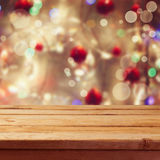 Christmas holiday background with empty wooden deck table over winter bokeh Stock Photography