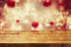 Christmas holiday background with empty wooden deck table over winter bokeh stock photos