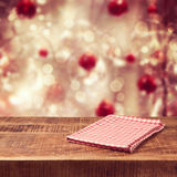 Christmas holiday background with empty wooden table and tablecloth. Ready for product montage royalty free stock photos