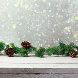 Christmas holiday background with empty wooden white table and christmas lights Stock Image