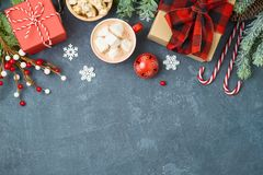 Christmas holiday background with gift boxes and hot chocolate cup on blackboard royalty free stock photography