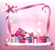 Christmas holiday background with gift boxes and pink ribbon. Royalty Free Stock Image
