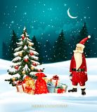 Christmas holiday background with gift boxes and Santa Claus Royalty Free Stock Photo