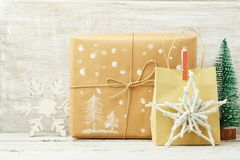 Christmas holiday background with gift boxs on wooden table stock photo