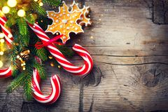 Christmas holiday background with gingerbread cookies, candy cane and evergreens border Royalty Free Stock Images