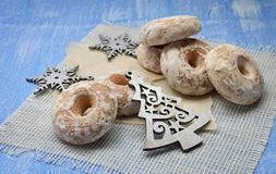 Christmas Holiday Background with Gingerbread cookies, Christmas decoration and sweets on wood backgroundÑŽ. Homemade gingerbread in sugar glaze on a wooden stock images