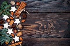 Christmas holiday background with gingerbread cookies and fir branches on the old wooden board. Copy space Stock Photos