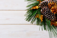 Christmas holiday background with golden decorated fir and pine Royalty Free Stock Photo