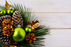 Christmas holiday background with green ornaments and golden con Stock Photos
