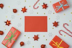Christmas holiday background with greeting card, gift boxes and stock photos