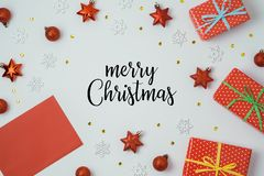 Christmas holiday background with greeting card, gift boxes and royalty free stock photo