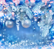 Christmas holiday background. Hanging baubles on Christmas tree Stock Images