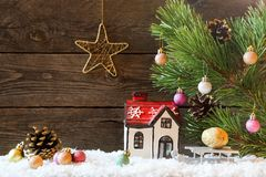 Christmas holiday background with a house in the snow and Christ stock photos
