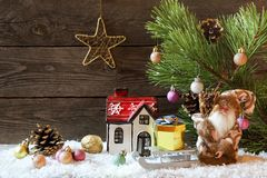 Christmas holiday background with a house in the snow and Christ royalty free stock images