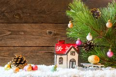Christmas holiday background with a house in the snow and Christ stock image